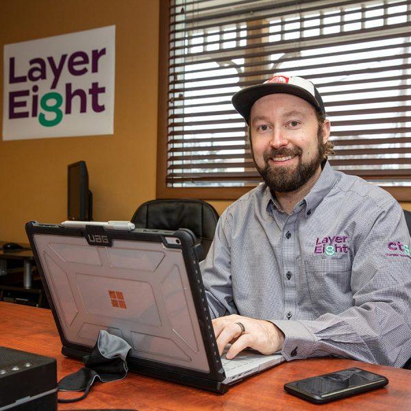 Technician using laptop in office