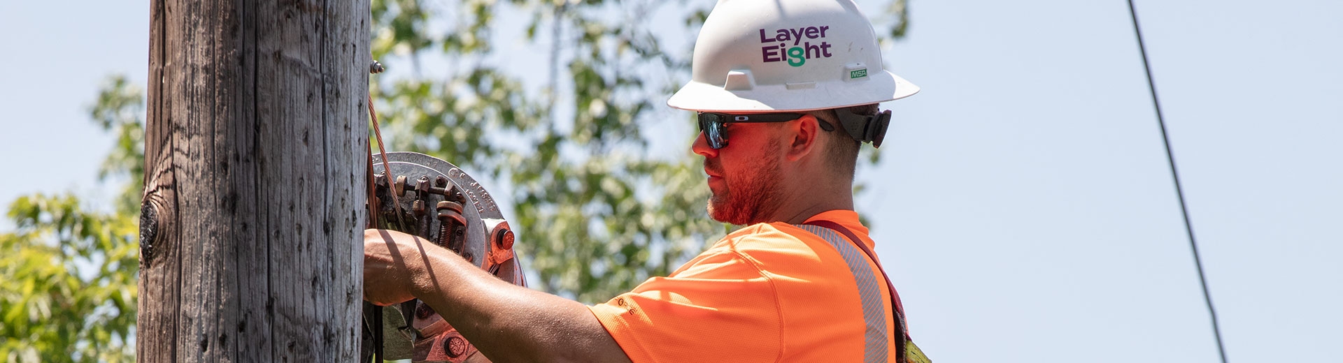 Construction support lineman working from a cherry picker truck