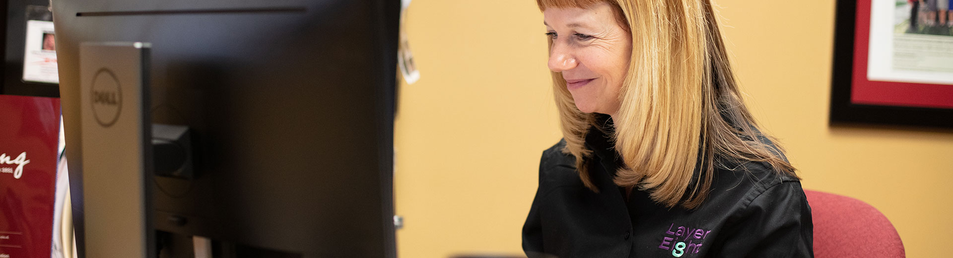 Woman working at LayerEight