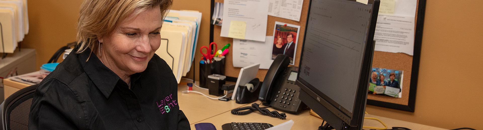 Champlain Technology worker at her desk